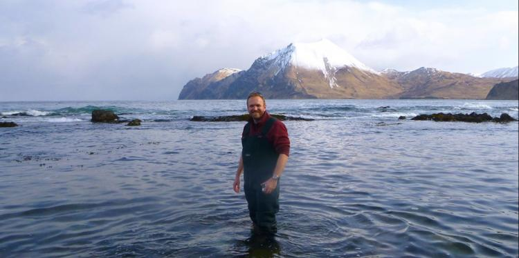 an Hewson standing in water in the Aleutian Islands, Alaska