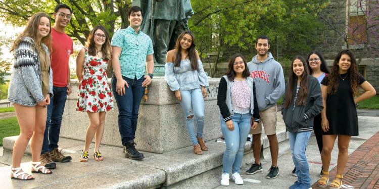 Students pose on Cornell's campus