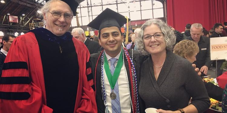 Sagar Chapagain stands at graduation with faculty and staff