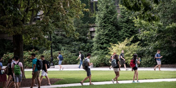 Students walk across quad