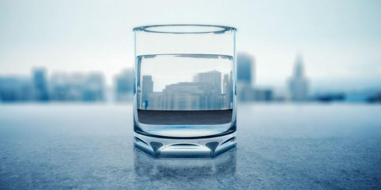 Glass of water overlooking the New York skyline