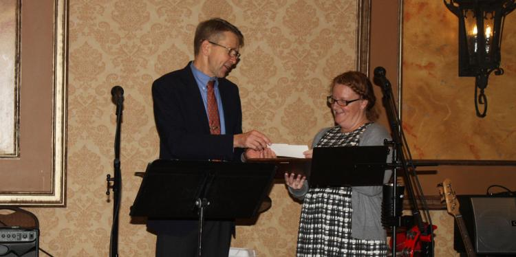 Sarah Lincoln receives an award from Jan Nyrop