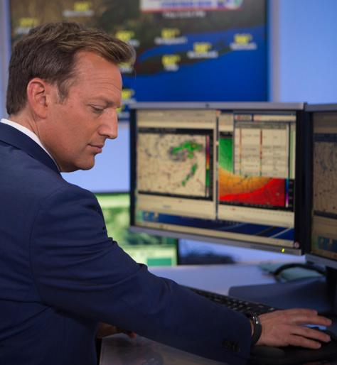 Meteorologist looking at data on the computer.
