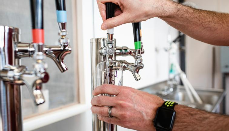 Pouring beer from tap.