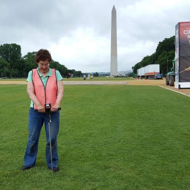 Researcher standing with the Washington Monument in the background