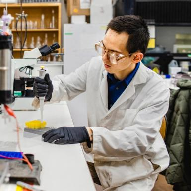 A man sitting at a lab bench doing research
