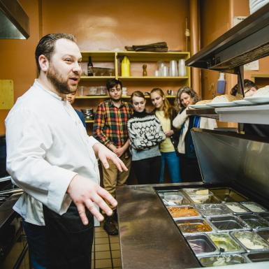 A local restaurant chef gives current students a tour behind the scenes of his kitchen.