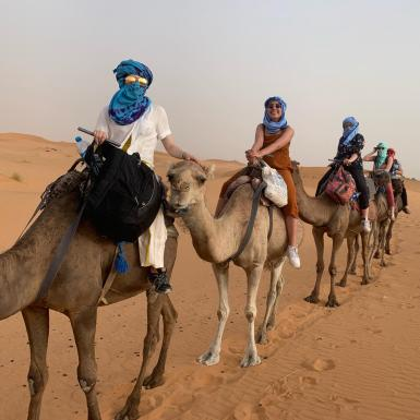 Four girls trek across the desert in Morocco on camels