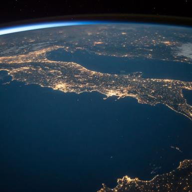 View from above of Earth showing city lights