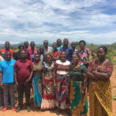 Group of Malawian farmers pose for picture in a field