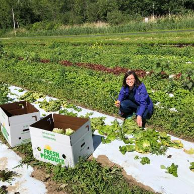 Julie Raway picking greens in a large garden