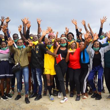 Group of Cameroonian youth pose with their hands raised