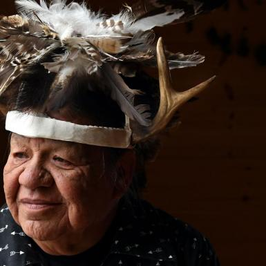 Portrait of a man wearing traditional Cayuga headress.