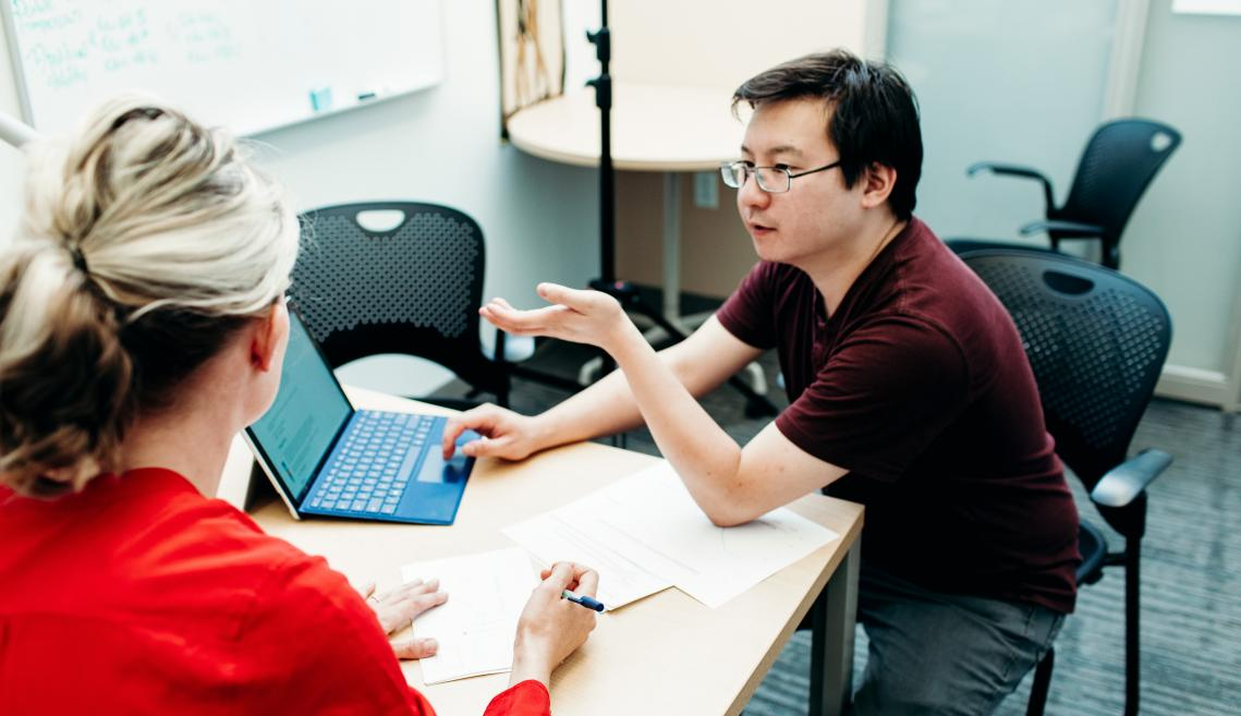 Lecturer Sarah Giroux and graduate student Anthony Poon discuss research