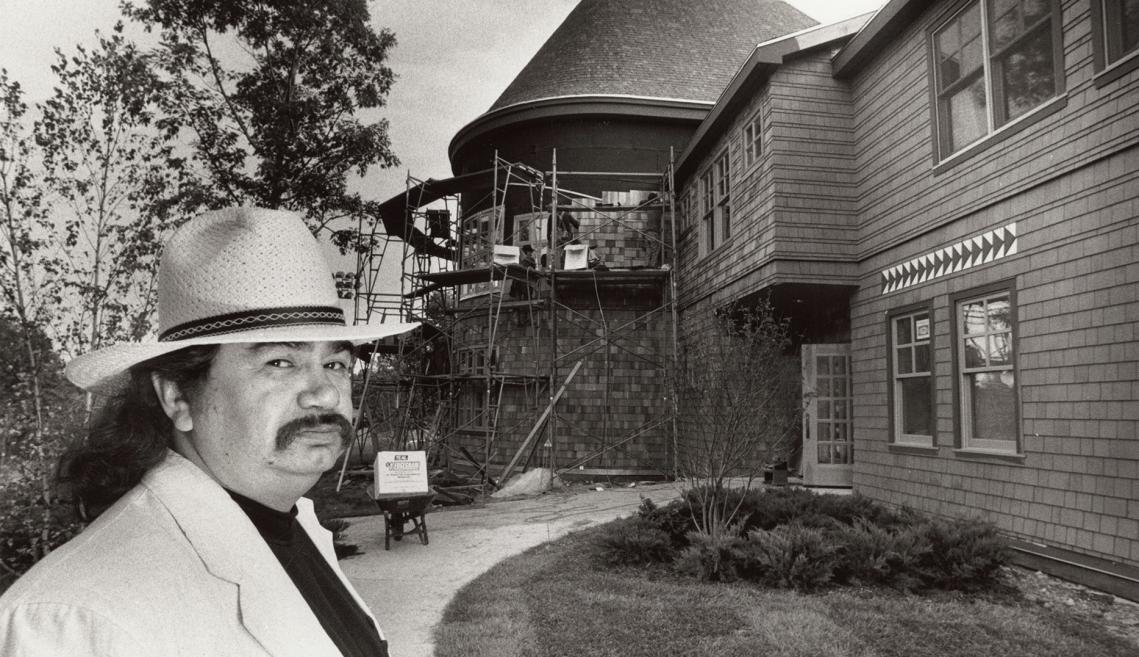 Dr. Ron LaFrance in front of Akwe:kon, while under construction.