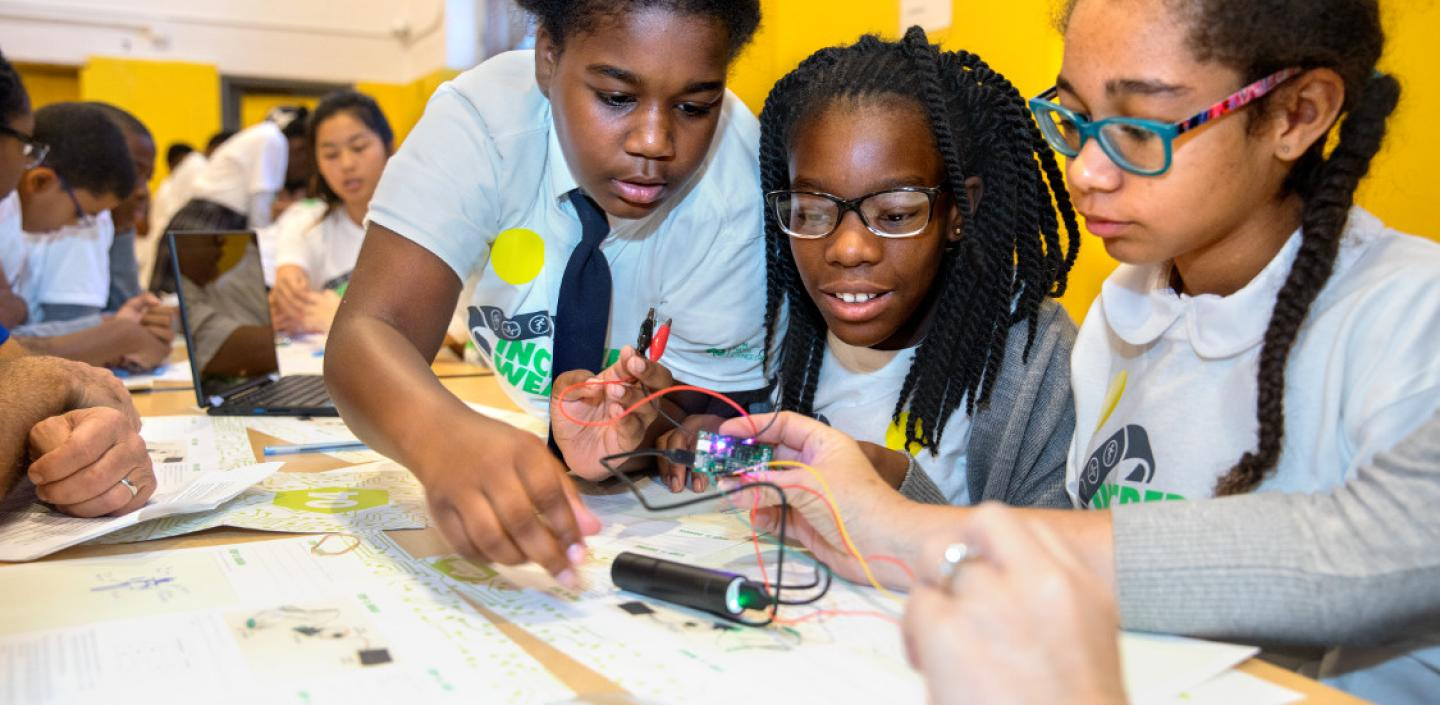 Children work on wearable technology at 2017's 4-H National Youth Science Day