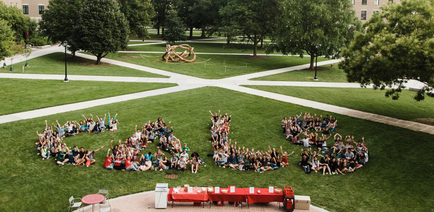 students on quad in the shape of CALS logo