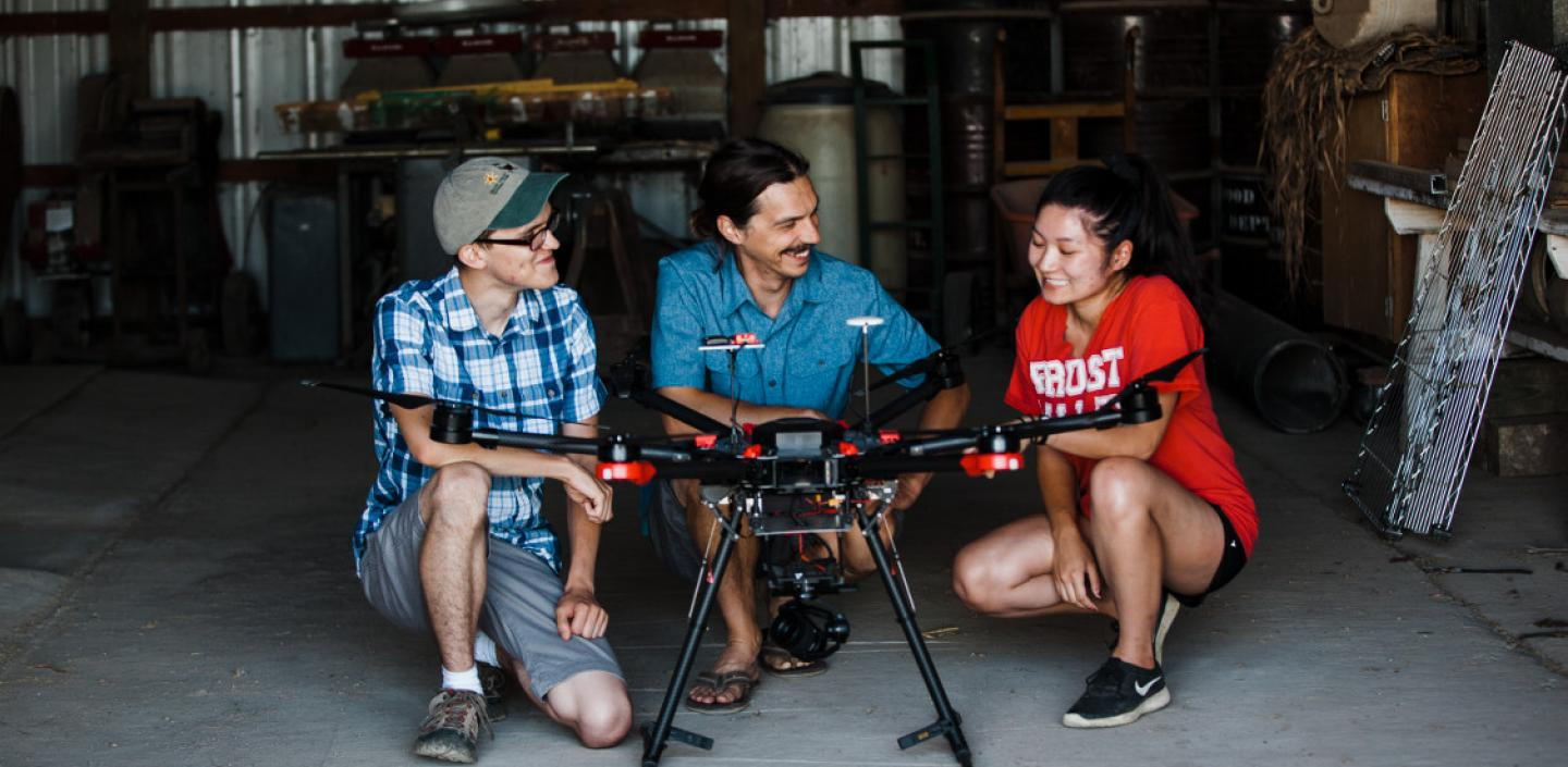 Students and researcher with a drone
