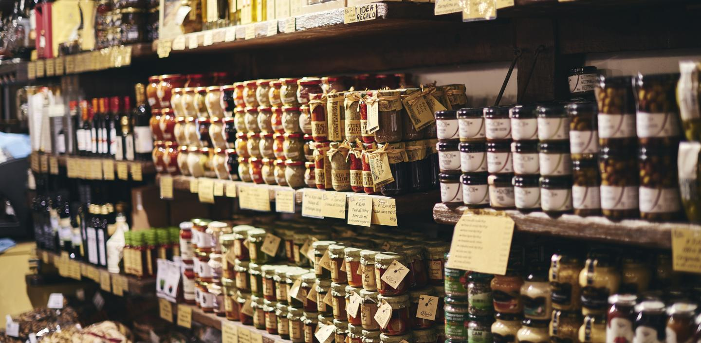 Grocery store shelving with jars of jam