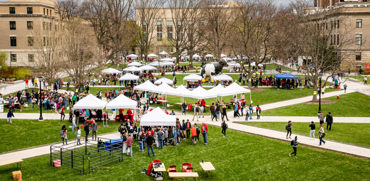 the ag quad at Cornell University with tents and students