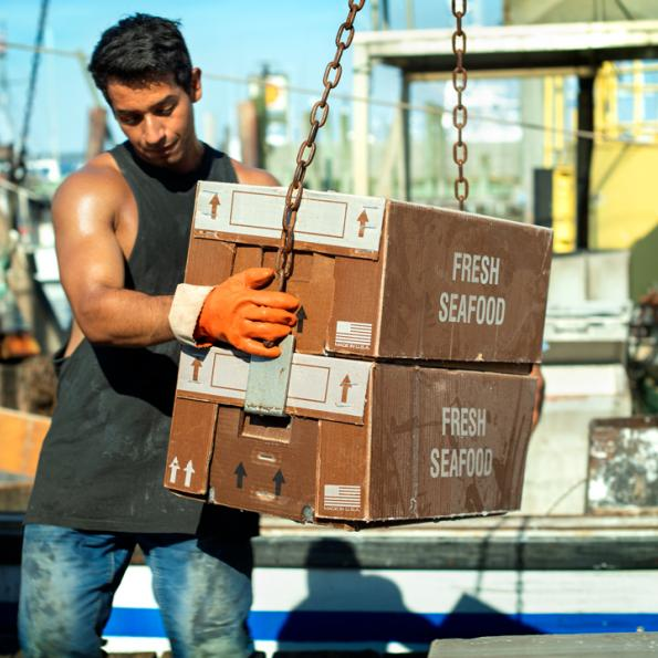 A stevedore unloads the day's catch on the Shinnecock Inlet in Hampton Bays.