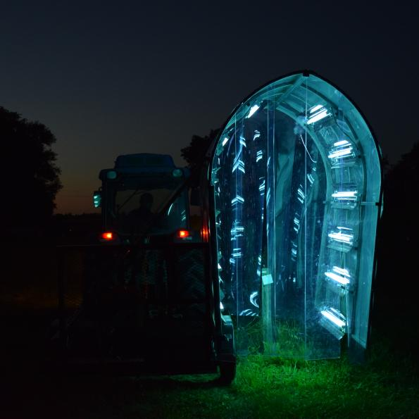 UV lights placed on crops in field.