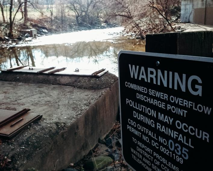 Warning sign near sewer overflow area in Washington DC