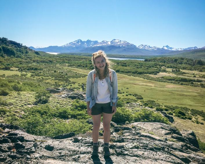 Hannah Fuller stands in front of the Patagonia mountains