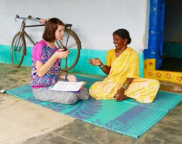 Student interviews a woman in India