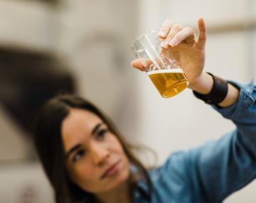 researcher analyzing beer