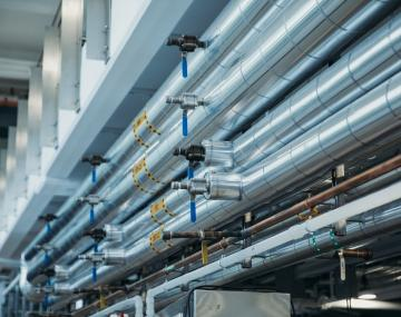 Metal pipes and valves in a building.