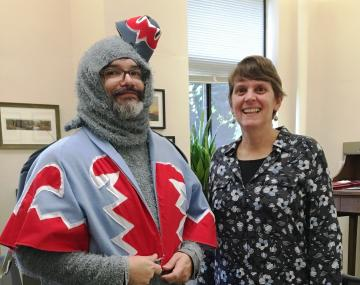 two people with one in a winged monkey costume
